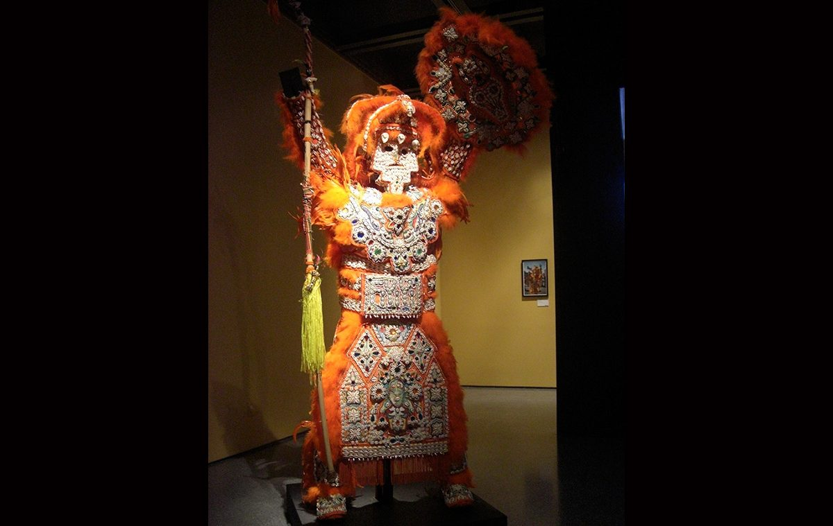 Victor Harris & Fi-Yi-Yi, Big Chief Suit, Shield, and Stick (Orange), 2002. Collection Victor Harris, Courtesy Victor Harris and the Backstreet Cultural Museum. Photo Claire Tancons