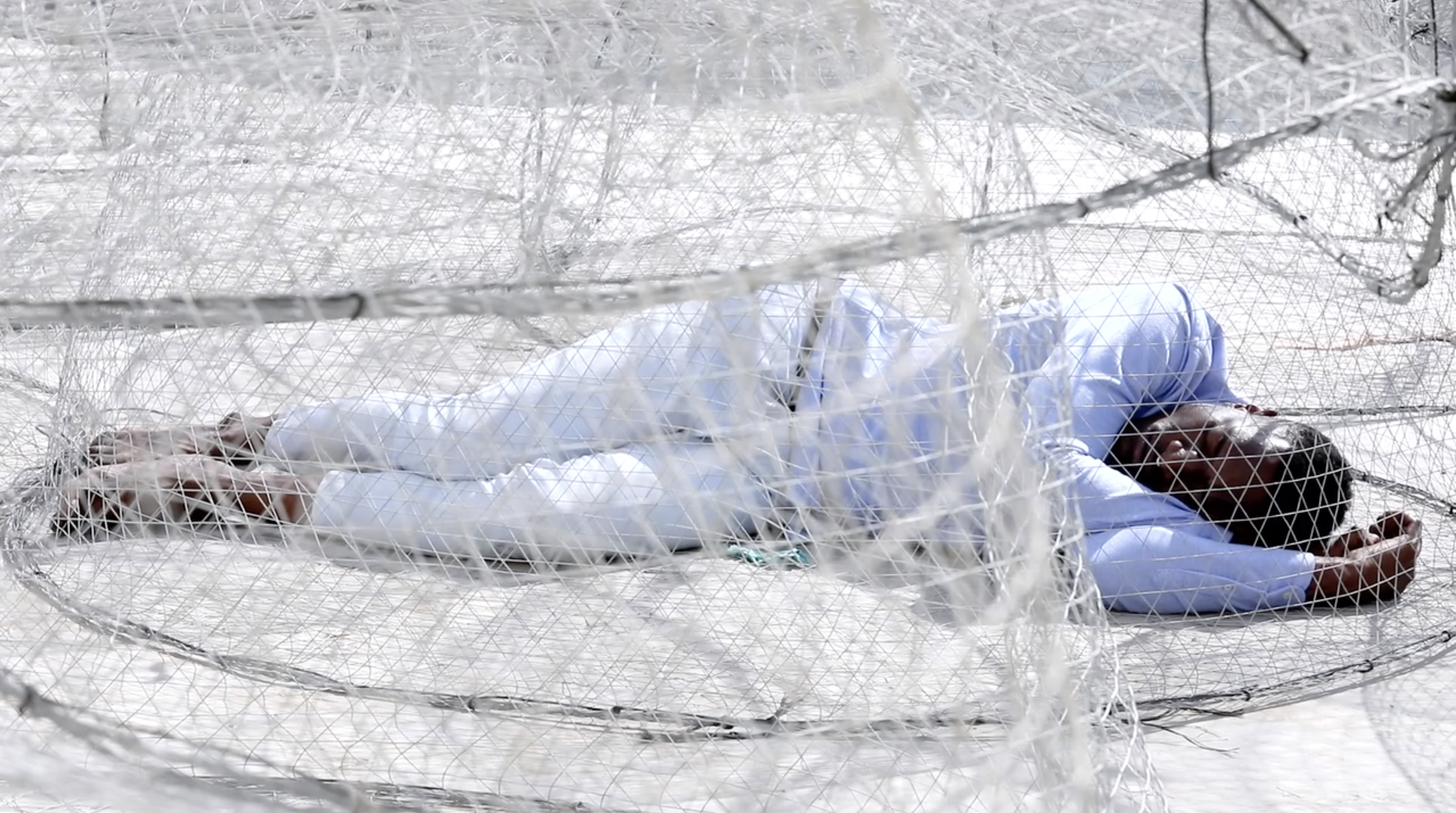 Carlos Martiel, Eslabón performance, March 9, 2019. Film Still Courtesy SAF